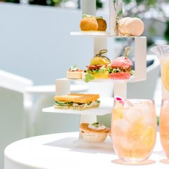 Let's sip! QT has launched an outdoor summer high tea featuring bottomless jugs of Aperol
